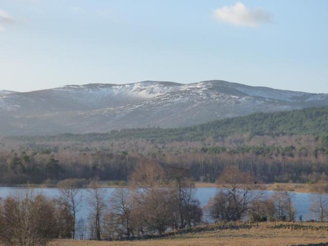 Looking across Loch Kinord towards Corn Arn