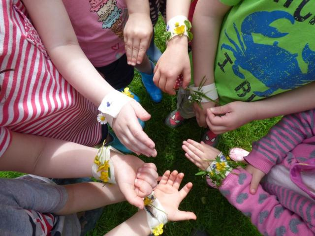 "Children from a local playgroup with their ""nature bracelets"""