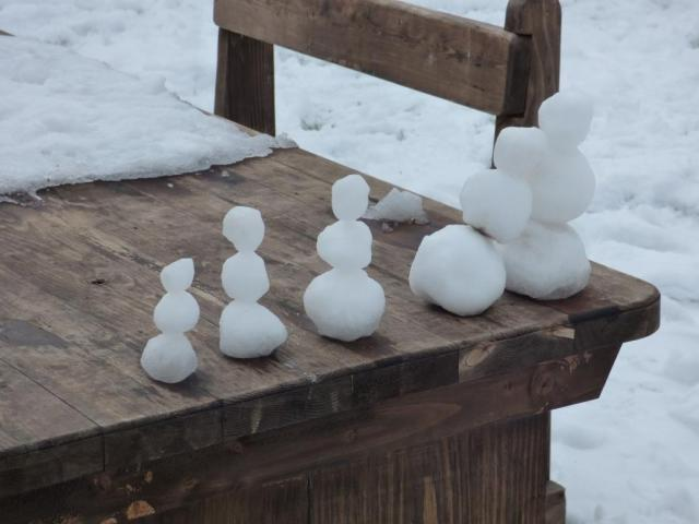 Mini snow family on picnic table