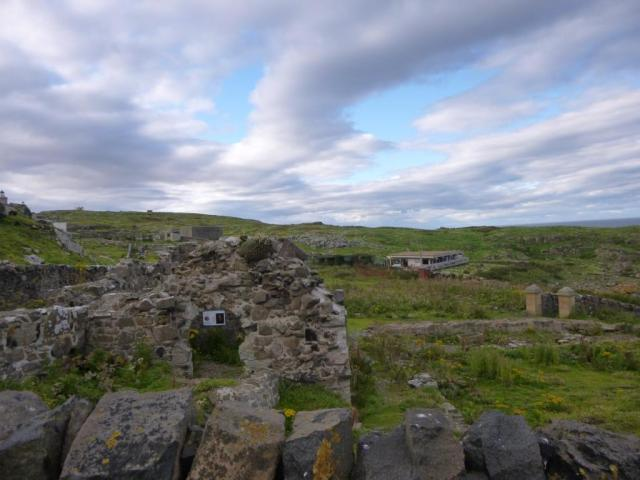The ruined priory with the visitor centre in the background