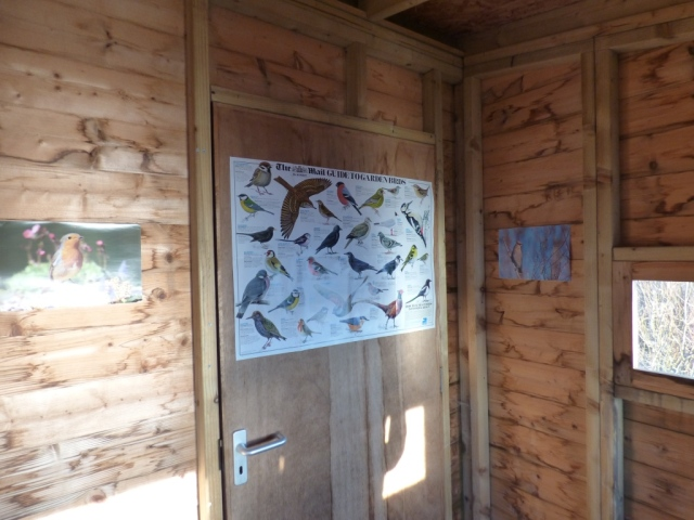 Pimp My Bird Hide- someone has added some smart posters to the bird hide!